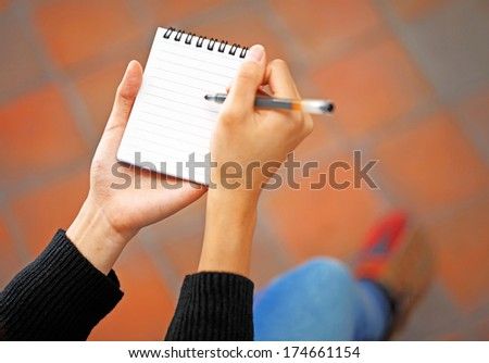 Woman hand jot note - stock photo