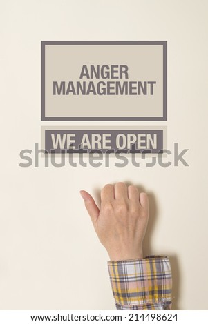 Woman hand knocking on the door of Anger Management office. - stock photo
