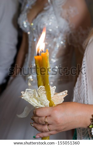 Woman hand lighting candles in a church  - stock photo