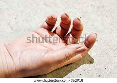 woman hand lying on road surface - stock photo