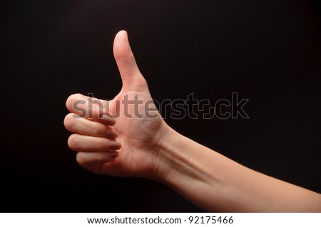 woman hand on black background