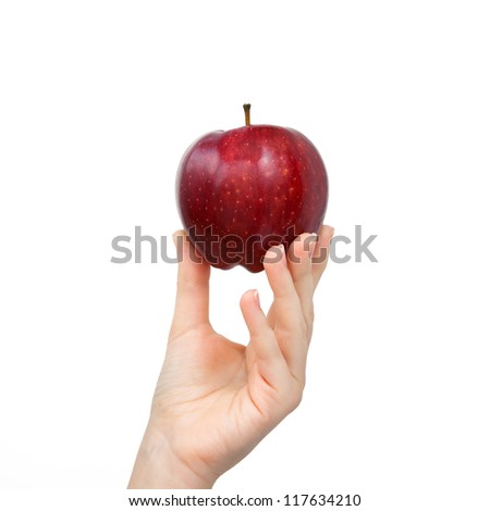 woman hand on isolated background holding a red apple