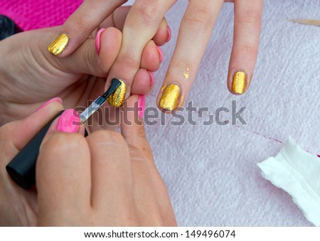 woman hand on manicure treatment nail polishing in beauty salon