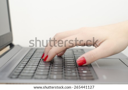 woman hand on the keyboard and white background