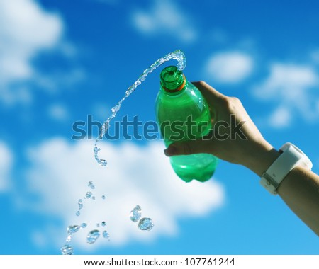 Woman hand pouring water. Outdoor activity concept - stock photo