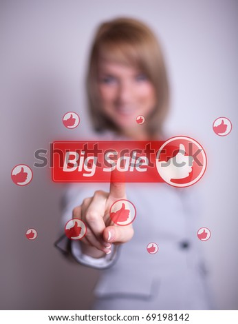 woman hand pressing BIG SALE button, backround in bokeh