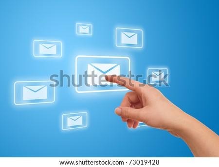 woman hand pressing e-mail icon - stock photo