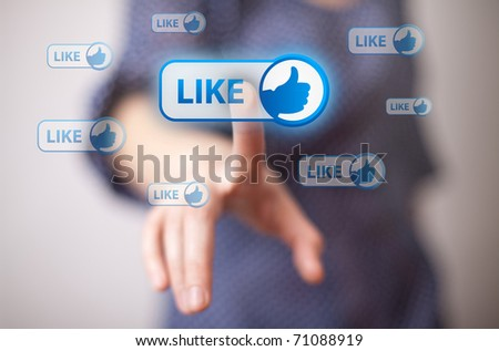 woman hand pressing Like button - stock photo