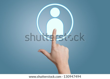woman hand pressing social media icon on blue background - stock photo