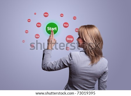 woman hand pressing START button - stock photo