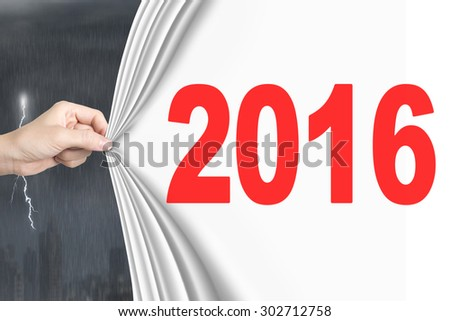 Woman hand pulling new 2016 white curtain covering lightning stormy weather - stock photo