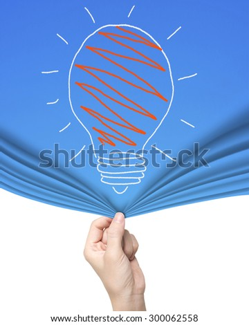 Woman hand pulling open light bulb blue curtain covering blank white background. - stock photo