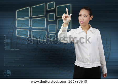 woman hand push on technology virtual touch screen interface - stock photo