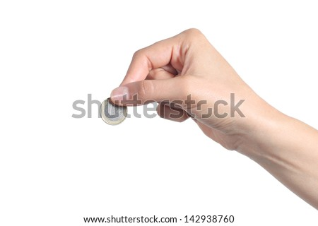 Woman hand putting an euro coin isolated on a white background - stock photo