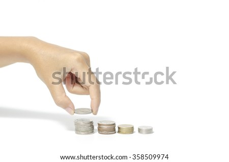 woman hand putting stack of coins on a white background