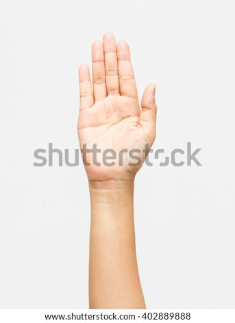 Woman hand raised on awhite background - stock photo