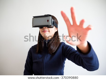 Woman hand raised up and touch something - stock photo