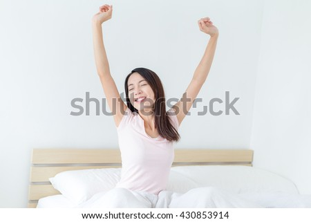Woman hand raised up at morning - stock photo