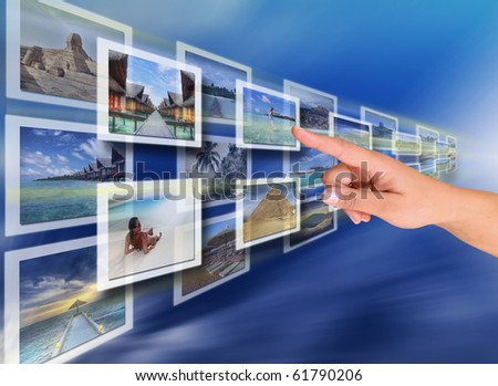 Woman hand reaching images on the screen - all pictures coming from my gallery - stock photo