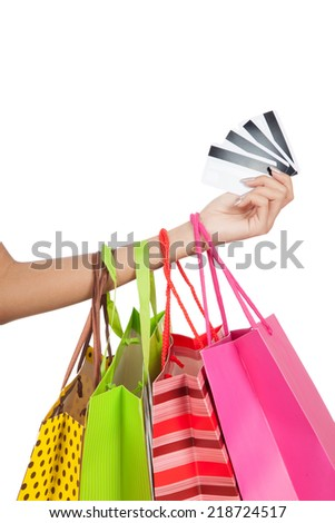 Woman hand show credit cards  with shopping bags  isolated on white background