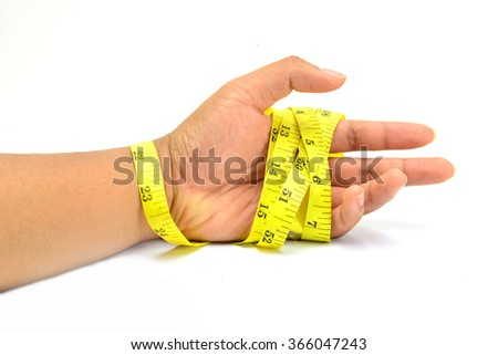 woman hand stretching a measure tape on a white isolated background .Concept of dieting and body care