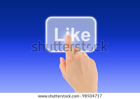 Woman hand uses virtual button on blue background