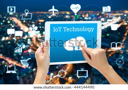 woman hand using smart phone in concept internet of things with blurred night modern city background