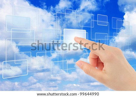 Woman hand using touch screen interface - stock photo