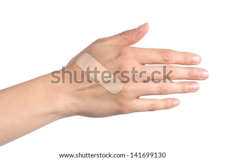 Woman hand with a band aid isolated on a white background - stock photo