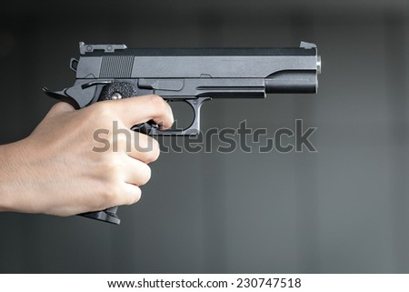 woman hand with a gun - stock photo