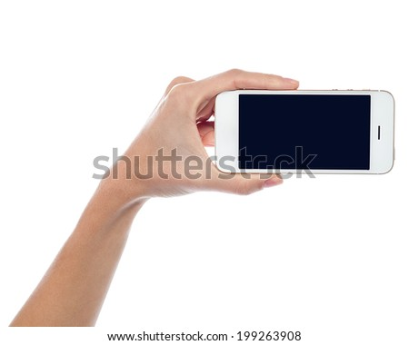 Woman hand with a new mobile handset - stock photo