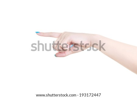 Woman hand with blue manicure pointing to the left isolated on a white background