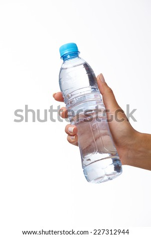 woman hand with bottle of water - stock photo