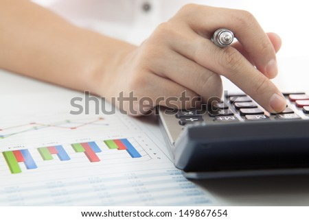woman hand with calculator and business report - stock photo