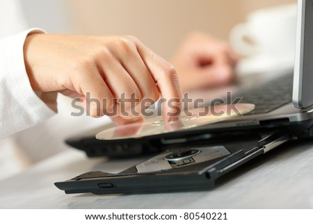 Woman hand with CD - stock photo