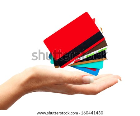 Woman hand with credit, discount cards isolated on white background. - stock photo