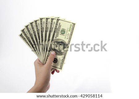 woman hand with dollars isolated on a white background with clipping path - stock photo