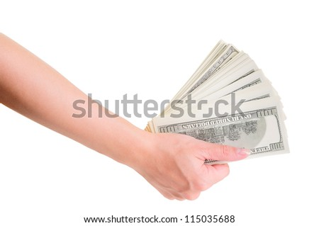 Woman hand with dollars isolated on white background - stock photo