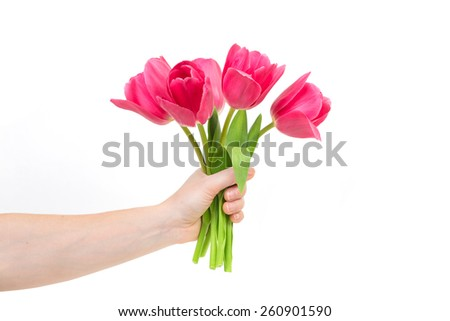 Woman hand with flowers. Isolated on white