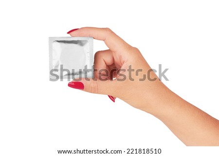 Woman hand with foil condom package isolated on white  - stock photo