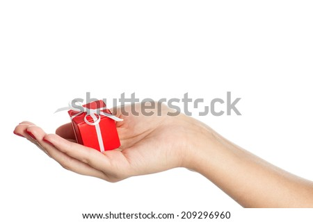 Woman hand with gift isolated on white background. Conceptual image - giving presents.
