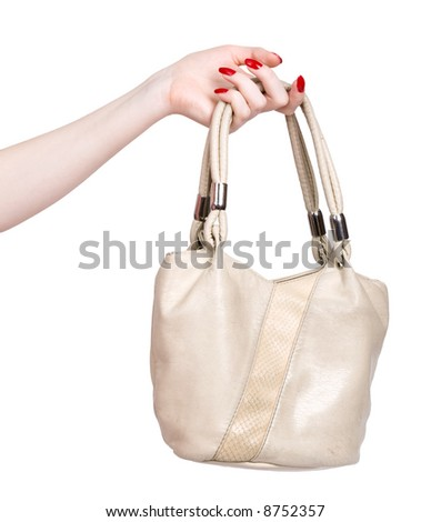Woman hand with handbag. Isolated on white. - stock photo