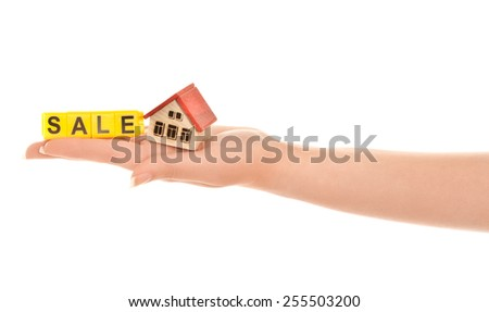 Woman hand with house and word sale isolated - stock photo