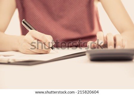 woman hand with pen and business report. Accounting
