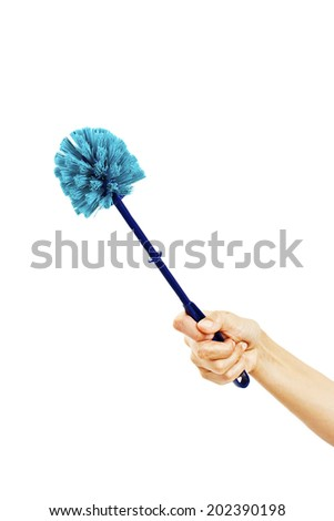 Woman hand with plastic blue toilet brush. Isolated on white background