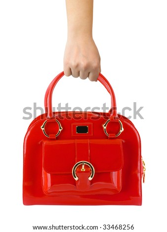 Woman hand with red bag isolated on white background - stock photo