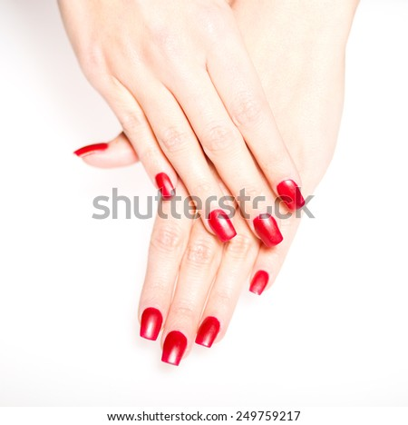 Woman hand with red nails isolated, manicure concept
