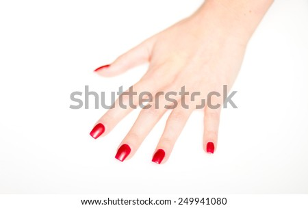 Woman hand with red nails isolated, manicure concept - stock photo