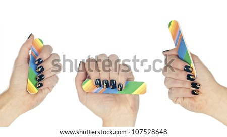 woman hand with stamped manicured nails holding nail file - stock photo