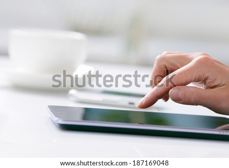 Woman hand with tablet PC - stock photo